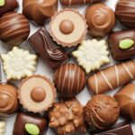 assorted chocolates confectionery on white background